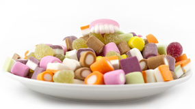 Plate of mixed sweets with teeth Royalty Free Stock Photography