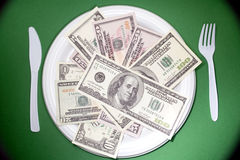 Plate of money Stock Photography