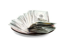 Plate with money Stock Images