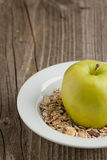 Plate of muesli with green apple Royalty Free Stock Images