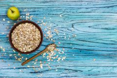 Plate with muesli on a wooden background. Healthy breakfast. Cop royalty free stock image