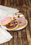Plate of  multicolored donuts on table Stock Image