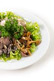 Plate with mushrooms salad greens Stock Photo