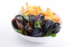 Plate of mussels and french fries Stock Images