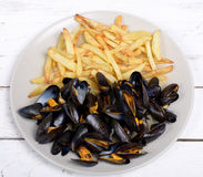 Plate of mussels and french fries Royalty Free Stock Photos