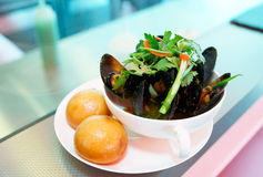Plate of mussels on takeout restaurant counter Stock Photos
