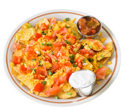 Plate of Nachos with Cheese. A plate of nachos and cheese, isolated on a white background Royalty Free Stock Images
