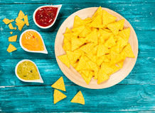 Plate of nachos with different dips Stock Photos