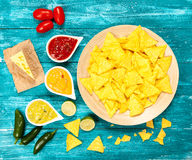 Plate of nachos with different dips Royalty Free Stock Photo