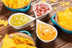 Plate of nachos with different dips Stock Images