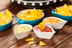 Plate of nachos with different dips Stock Photography