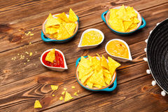 Plate of nachos with different dips Royalty Free Stock Photography