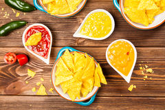 Plate of nachos with different dips Stock Image