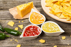 Plate of nachos with different dips Royalty Free Stock Images