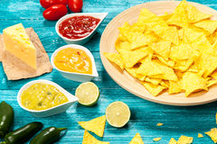 Plate of nachos with different dips Royalty Free Stock Image