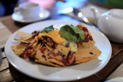 Plate with nachos and sauces Royalty Free Stock Image
