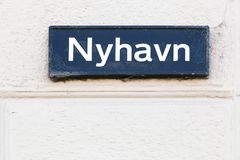 Plate with the name of the street Nyhavn in Copenhagen Royalty Free Stock Photo