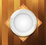 Plate with napkin. On wood background Royalty Free Stock Photo