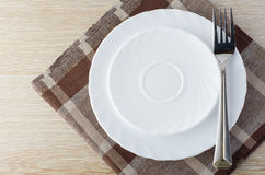 Plate on a napkin. Breakfast, plate on a napkin, table Royalty Free Stock Photos