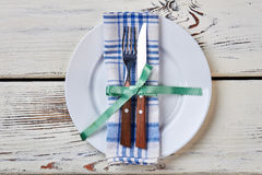 Plate with napkin and cutlery. Stock Photography