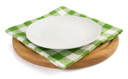 Plate with napkin at cutting board Royalty Free Stock Images