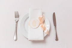 Plate with napkin with pink ribbon on the table in restaurant Stock Photography