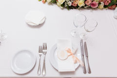 Plate with napkin with pink ribbon on the table in restaurant Royalty Free Stock Image