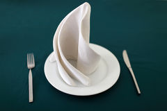 Plate and napkin on table Stock Photos