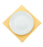 Plate at napkin on white Stock Images