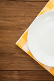 Plate at napkin on wood Stock Photography