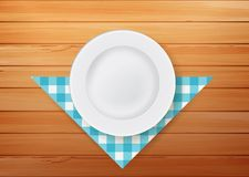 Plate with napkin on wood background Stock Photos