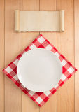 Plate and napkin on wood Stock Photos
