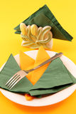 Plate with napkins and fork Royalty Free Stock Image