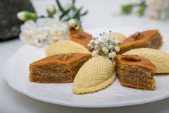 A plate with national pakhlava and shekarbura. As Novruz symbol royalty free stock images