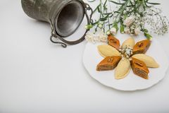 A plate with national pakhlava and shekarbura. As Novruz symbol royalty free stock photo
