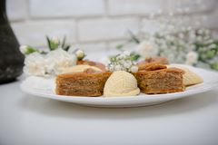 A plate with national pakhlava and shekarbura. As Novruz symbol royalty free stock photography