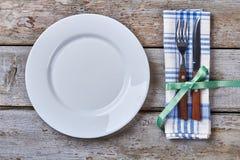 Plate near cutlery. Stock Photos