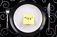 Plate with note hungry stock image