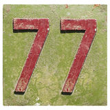 Plate with a number 77 Royalty Free Stock Photography