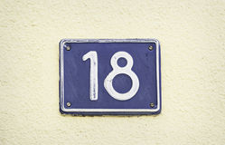 Plate with number eighteen Stock Images