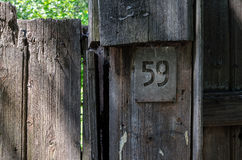 The plate number 59 on an old wooden fence Royalty Free Stock Photo