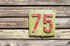 Plate with a number on the wall Royalty Free Stock Image