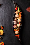 Plate with nuts and berries Stock Photography