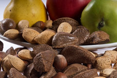 Plate of nuts and Fruit Stock Image
