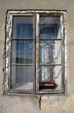Plate with nuts in an old window. Plate with nuts in an old dilapidated window stock photo