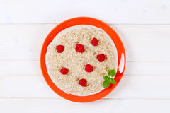 Plate of oatmeal porridge Stock Photos