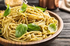 Free Plate Of Delicious Basil Pesto Pasta On Table Stock Images - 131593744