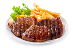 Plate Of Grilled Meat With Fries Stock Photos