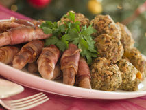 Plate Of Pigs In Blankets And Chestnut Stuffing Stock Photos