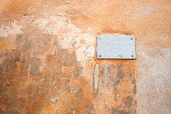 A plate on an old painted textured wall Royalty Free Stock Photo